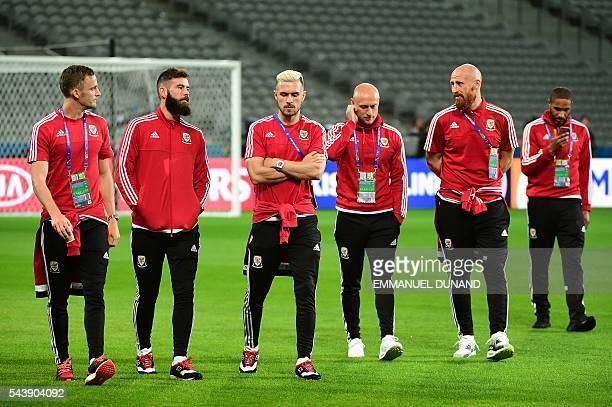 Wales' midfielder Andy King Wales' midfielder Joe Ledley Wales' midfielder Aaron Ramsey Wales' forward David Cotterill Wales' defender James Collins...