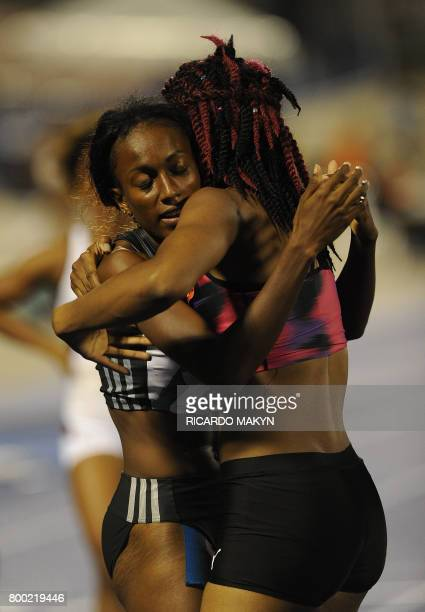 From left winner Ronda Whyte is congratulated by second place Ristanana Tracey after the women's 400m hurdles final at the Jamaica National Senior...
