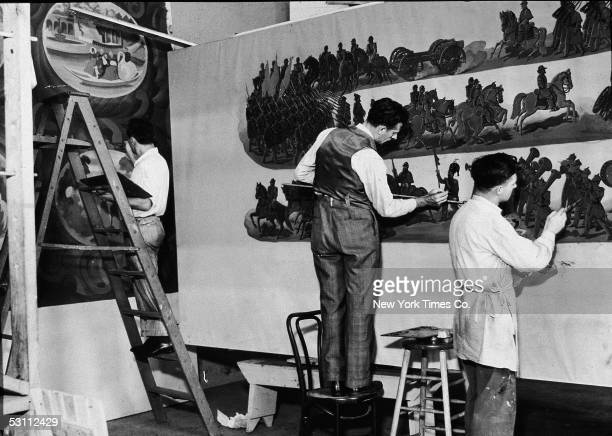 WPA artists John Alotta Phillip Reisman and John Lamont at work in a temporary studio in the American Museum of Natural History paint murals...