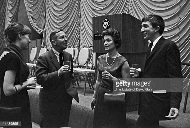 From left Writer John Cheever his wife Mary Cheever writer John Updike and his wife Mary Pennington Updike celebrate at the National Book Awards held...