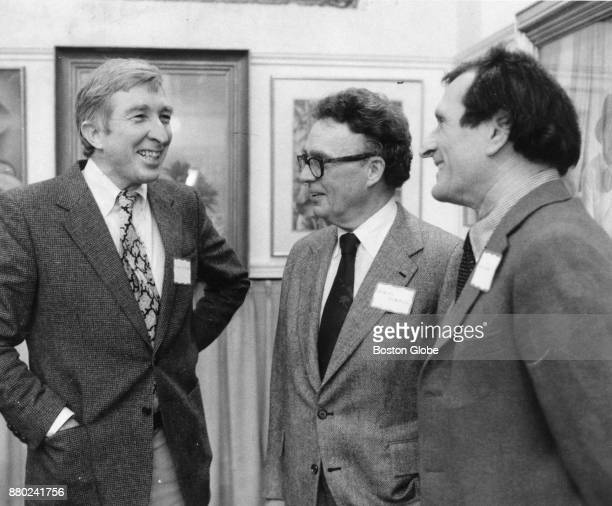 From left writer John Updike talks with Atlantic Monthly Editor Robert Manning and biographer Justin Kaplan at the Athenaeum in Boston on Jan 25 1979