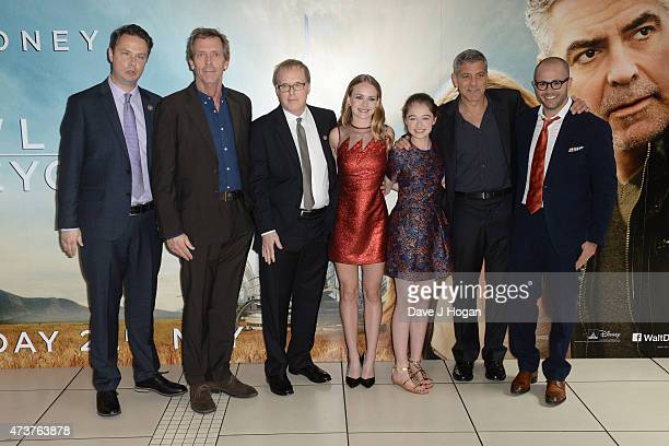 From leftright Jeff Jenson Hugh Laurie Brad Bird Britt Robertson Raffey Cassidy George Clooney and Damon Lindelof attend the Tomorrowland A World...