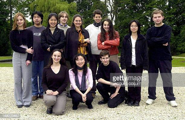 From LR bottom row US Christina Castelli Japanese Akiko Ono and American Mikhail Ovrutsky top row LR Latvian Baiba Skribe Chinese Feng Ning South...