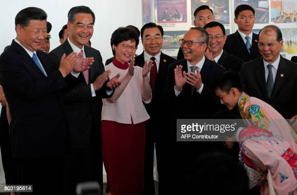 Chinese president Xi Jinping Hong Kong Chief Executive Leung Chunying and Chief Executiveelect Carrie Lam applaud after watching two Chinese opera...