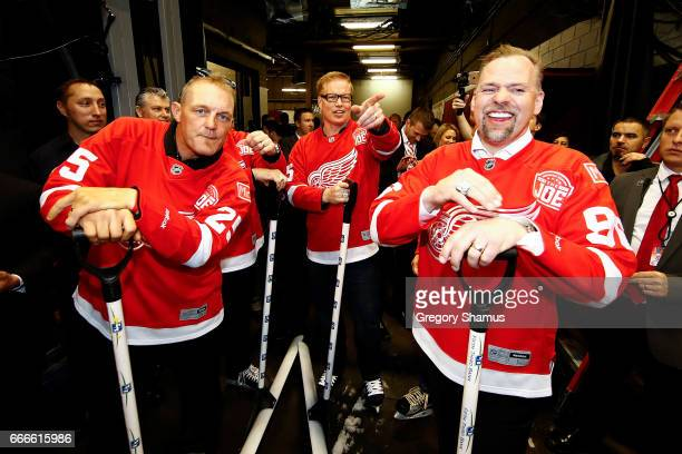 From LR Former Detroit Red Wings Darren McCarty Larry Murphy and Tomas Holmstrom prepare to shovel the ice during a timeout at the last NHL game at...
