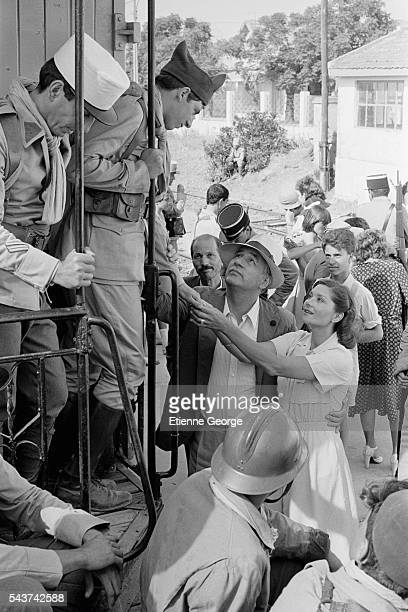 """French actors Michel Creton, Patrick Bruel, Philippe Noiret and Macha Méril on the set of the film """"Le Grand carnaval"""" , directed by Alexandre Arcady."""