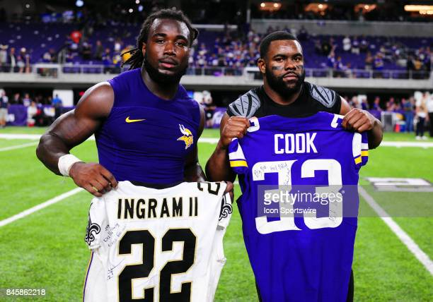 From LR Minnesota Vikings running back Dalvin Cook and New Orleans Saints running back Mark Ingram hold up the jerseys they just traded each other...
