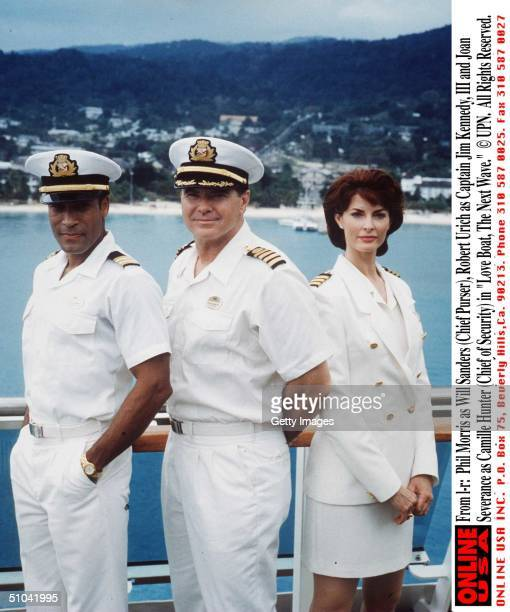 Phil Morris As Will Sanders Robert Urich As Captain Jim Kennedy Iii And Joan Severance As Camille Hunter In Love Boat The Next Wave