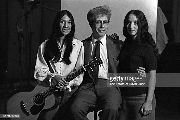 From lr singer songwriter Buffy SainteMarie Vanguard Records founder Maynard Solomon and singer and musician Maria Muldaur pose for a portrait...