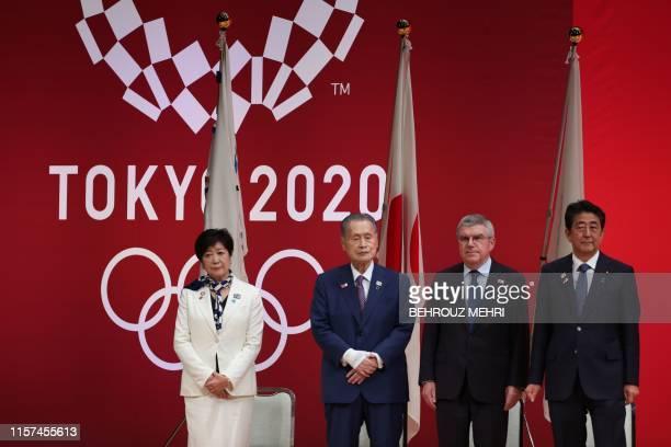 Tokyo Governor Yuriko Koike, Tokyo 2020 Organising Committee president Yoshiro Mori, International Olympic Committee president Thomas Bach, and...