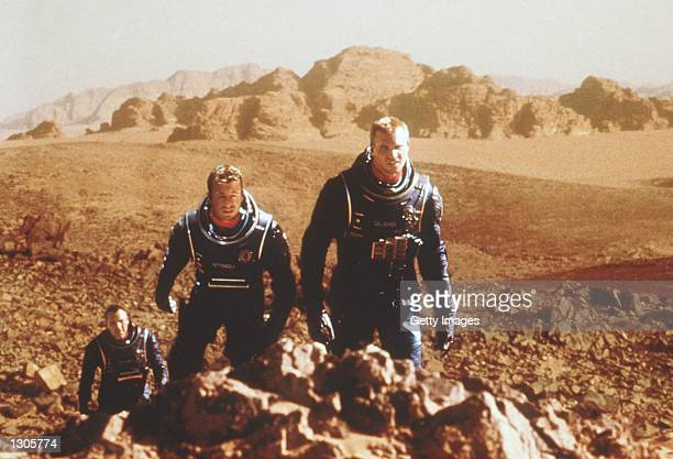 From lr Tom Sizemore Simon Baker and Val Kilmer travel to Mars to investigate human living conditions on that planet in Warner Bros Pictures'' and...