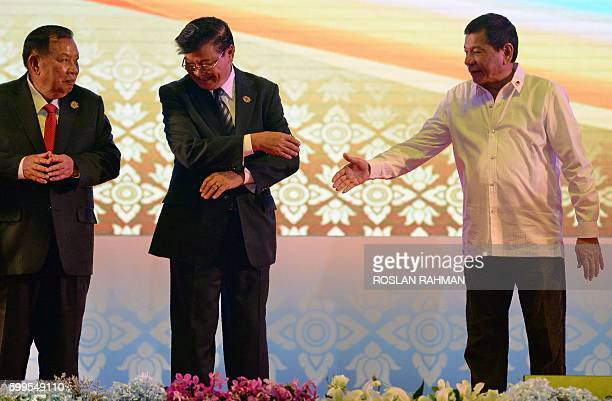 Vietnam's Prime Minister Nguyen Xuan Phuc Laos Prime Minister Thongloun Sisoulith and Philippine President Rodrigo Duterte attend the opening of the...