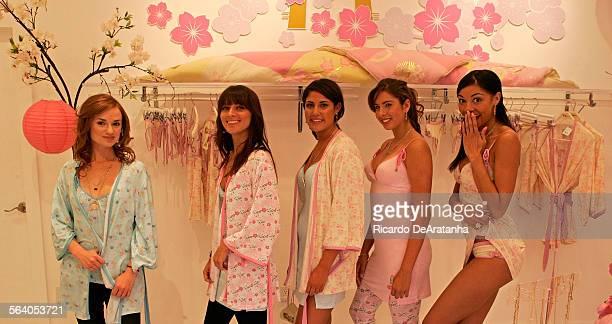 Michelle Foody cq Alaina Etue cq Jessica Fuerstman cq Ali Rambis and Candace Jackson cq modeling Kidada Jones' line of couture loungewear costume...