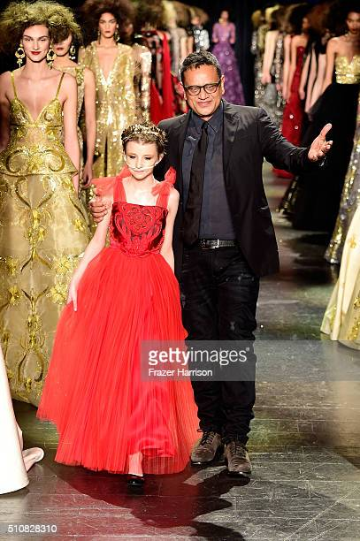 From MakeAWish Foundation Trinity Faith Moran and designer Naeem Khan greet the audience from the runway at Naeem Khan Fall 2016 during New York...