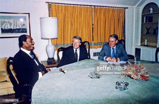 From of, from left, Egyptian President Anwar Al Sadat , US President Jimmy Carter, and US Secretary of State Cyrus Vance seated around a table during...