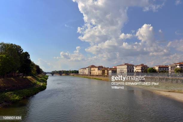 From Ponte Amerigo Vespucci along the Arno River past Florence Dungeon in Florence, Italy