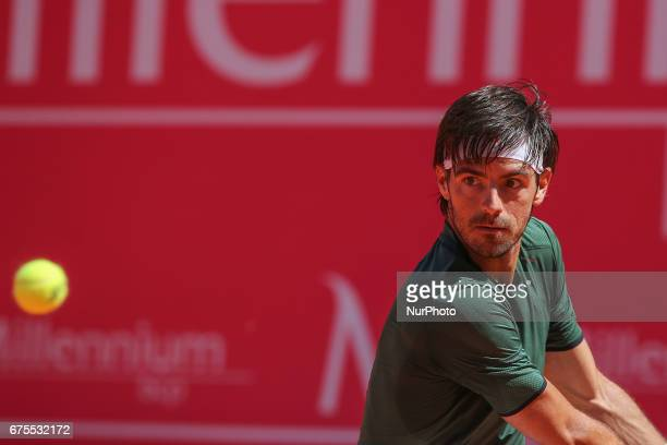 ELIAS from PORTUGAL in action during the match Gastao Elias between Malek Jaziri for Millennium Estoril Open at Clube de Tenis do Estoril on May 1...