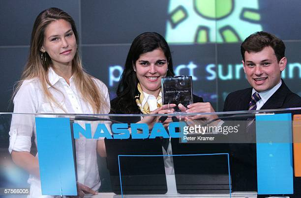 From Project Sunshine model Bar Refaeli executive director Amy Saperstein and founder Joe Weilgus attend the NASDAQ closing bell in Times Square on...