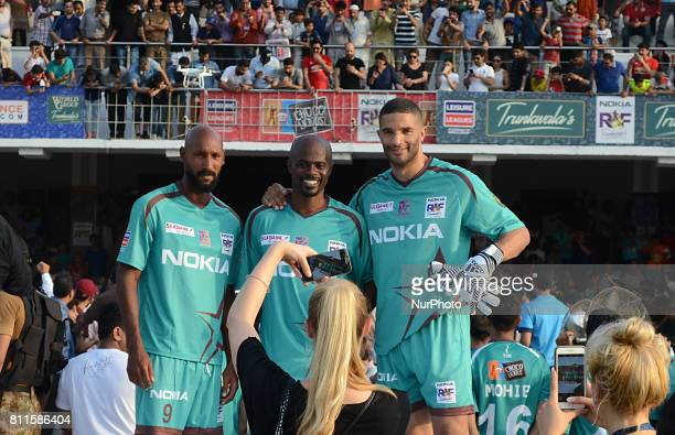 from R Former England goalkeeper David James Dutch midfielder George Boateng and former French player Nicolas Anelka pose during a ceremony before a...