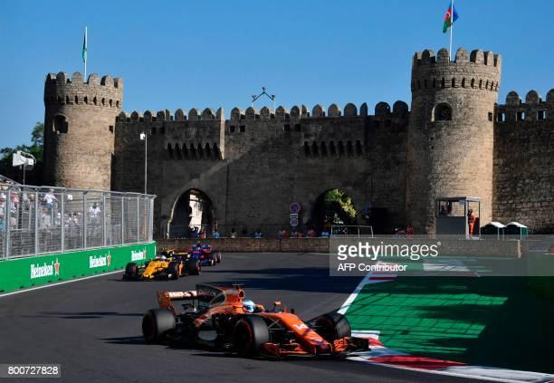 McLaren's Spanish driver Fernando Alonso Renault's British driver Jolyon Palmer and Torro Rosso's Spanish driver Carlos Sainz Jr steer their cars...
