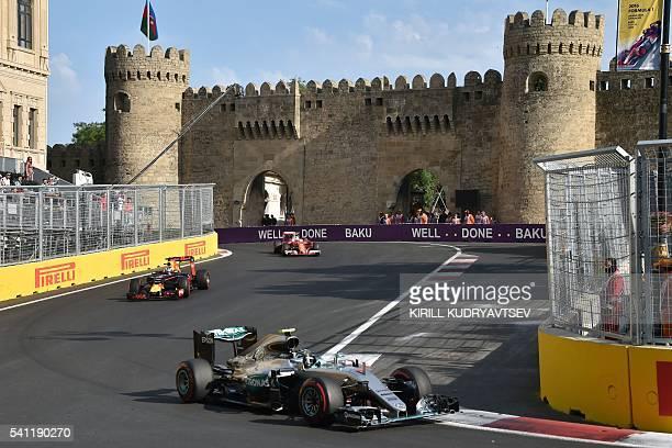 Mercedes AMG Petronas F1 Team's German driver Nico Rosberg, Red Bull Racing's Australian driver Daniel Ricciardo and Scuderia Ferrari's German driver...