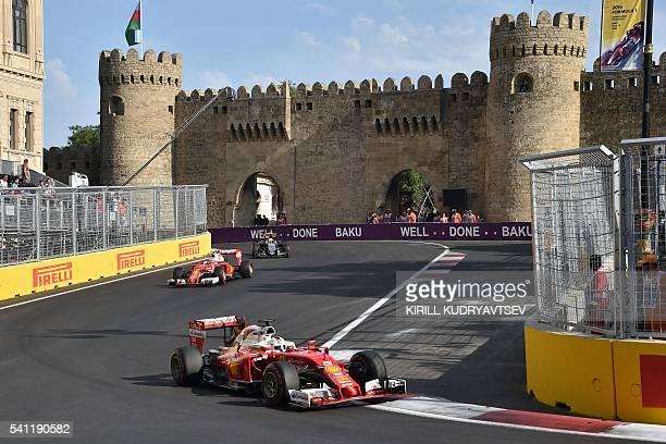 Scuderia Ferrari's German driver Sebastian Vettel Scuderia Ferrari's Finnish driver Kimi Raikkonen and Sahara Force India F1 Team's Mexican driver...