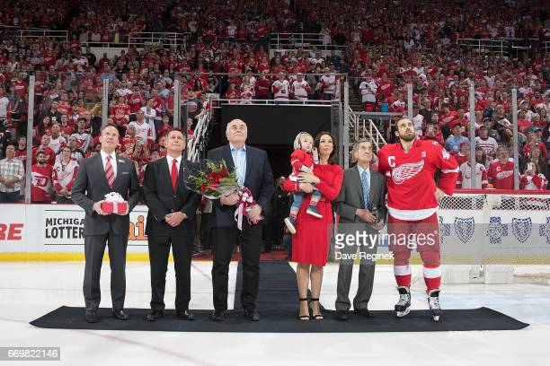From R to L Henrik Zetterberg of the Detroit Red Wings former Detroit Red Wing Ted Lindsay wife Emma Andersson Zetterberg holding her son Love father...