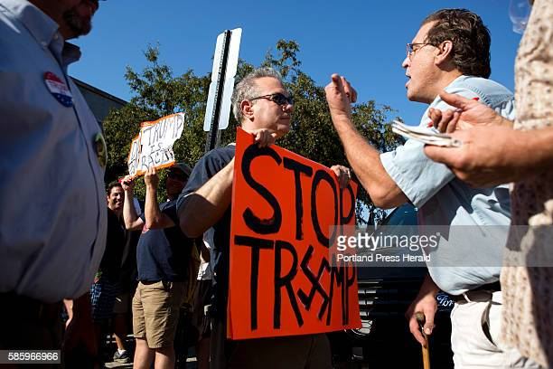 From right Bruce Poulin of Winslow a Trump supporter argues with Trump protester Harvey who declined to give his last name after the Donald Trump...