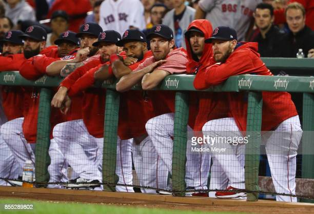 From right Chris Sale Rick Porcello Doug Fister Chris Young of the Boston Red Sox look on from the dugout during the first inning against the Houston...