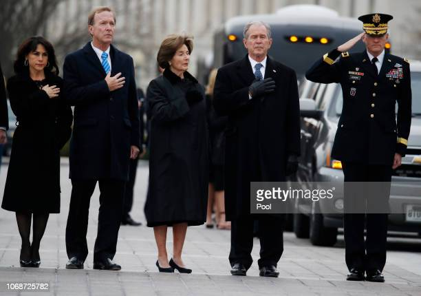 From right former President George W Bush second from right former first lady Laura Bush Neil Bush and Sharon Bush stand as a joint services military...