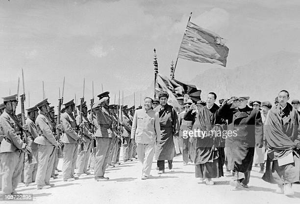 Panchen Lama Chinese vicepremier Chen Yi and the Dalai Lama review a Tibetan guard of honour wearing Chinese army uniforms in May 1956 in Lhasa the...