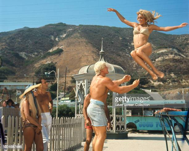 From right to left, actors Sharon Tate as Malibu, bodybuilder Dave Draper as Harry Hollard and Tony Curtis as Carlo Cofield in the film 'Don't Make...