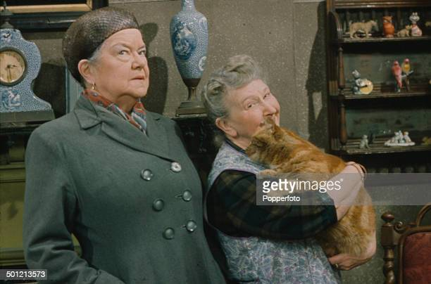 From right to left English actresses Margot Bryant as 'Minnie Caldwell' holding a pet cat and Violet Carson as 'Ena Sharples' pictured together in a...