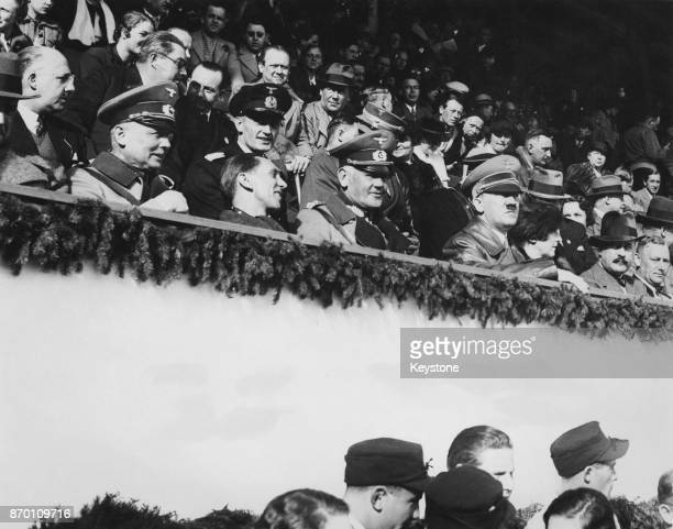 From right to left German Chancellor Adolf Hitler General Werner von Blomberg Joseph Goebbels and General Werner von Fritsch watch the final ski...