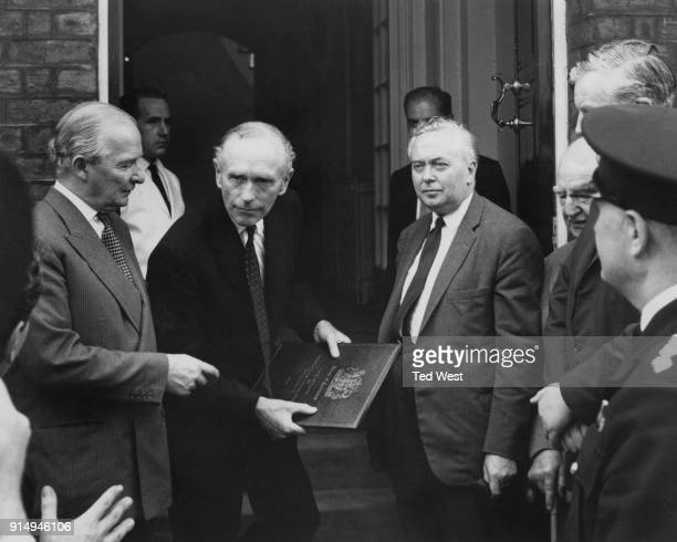 From right to left Harold Wilson the Leader of the Opposition Prime Minister Sir Alec DouglasHome and Selwyn Lloyd Leader of the House arrive at the...