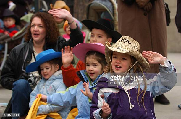 From right to left JoAnna <cq> 6 Neena <cq> 4 Jacob <cq> 8 and Sophia <cq> 3 and their mother Gina O'Connell <cq> of Aurora cheer as the Westernaires...