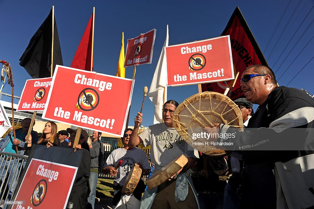 American Indian Movement protest the Washington Redskins as they arrive in town to play the Denver Broncos at Sports Authority Field at Mile HIgh in Denver, Co. : News Photo