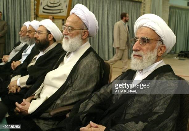 Leading Iranian cleric Ayatollah Ahmad Jannati and Iranian speaker at Friday prayers Imam Kashani listen to Ayatollah Ali Meshkini conservative...