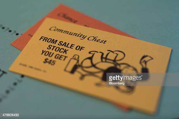 A 'From Sale Of Stock' Community Chest card is arranged on a Hasbro Inc Monopoly board game for a photograph taken with a tiltshift lens in Oradell...