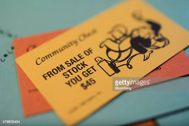 """From Sale Of Stock"""" Community Chest card is arranged on a Hasbro Inc. Monopoly board game for a photograph taken with a tilt-shift lens in Oradell,..."""