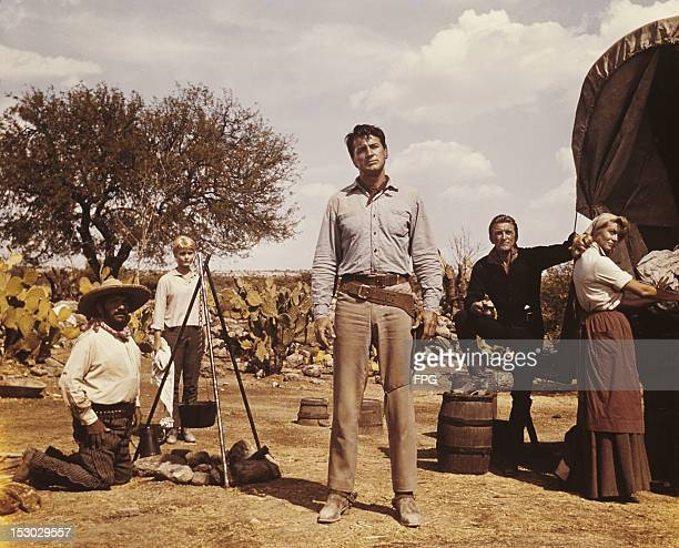 From second left, American actors Carol Lynley , Rock Hudson , Kirk Douglas , and Dorothy Malone in a scene from the film 'The Last Sunset,' 1961.