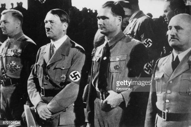 From second left to right Nazi Party officials Adolf Hitler Rudolf Hess and Julius Streicher circa 1937