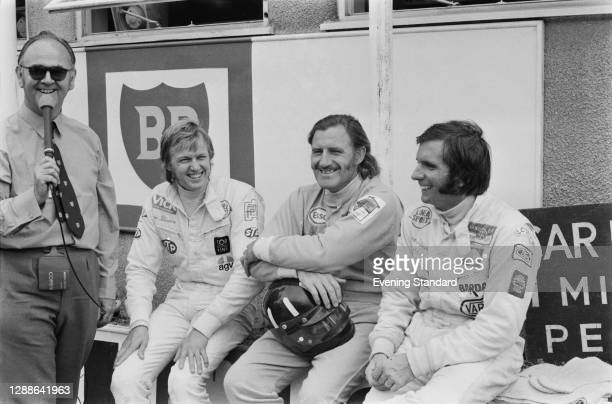 From second left to right, racing drivers Ronnie Peterson, Graham Hill and Emerson Fittipaldi at Brands Hatch, UK, during the Rothmans International...