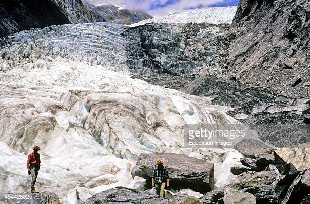 From snout of Franz Josef Glacier Longitudinal crevasses where valley widens transverse crevasses beyond where valley steepens West CoaSt New Zealand