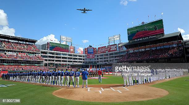 A C130 from the 136th Arlift Wing Texas Air National Guard performs a flyover as the Texas Rangers play host to the Toronto Blue Jays in Game 1 of...