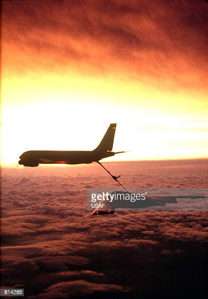 A KC135 from the 22nd Air Refueling Wing McConnell Air Force Base Kansas refuels a B2 Spirit from the 509th Bomb Wing Whiteman Air Force Base...