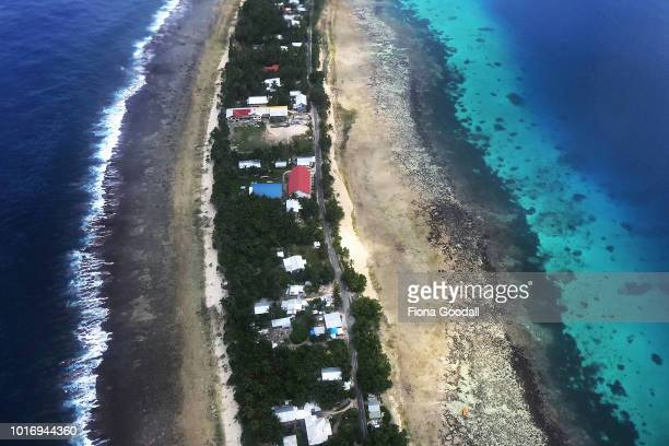 From the air the ocean and the logoon and separated by a thin stip of land on August 15 2018 in Funafuti Tuvalu The small South Pacific island nation...