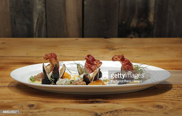 From the appetizer menu at Caiola's in Portland's West End Black Mission Figs with gorgonzola honey rasperries and crispy prosciutto