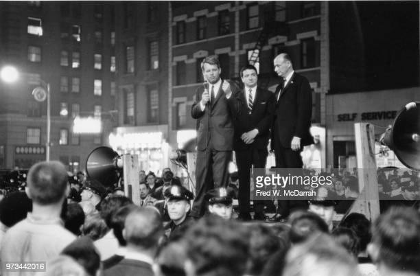 From the back of a flatbed truck American politician former US Attorney General Robert F Kennedy campaigns for the US Senate to crowd at the...