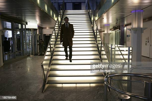 GERMANY MUNICH From the bottom lighted stairways with a person as a silhouette in the headquarters of the BayernLB